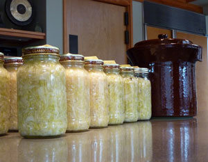 Sauerkraut in jars with crock